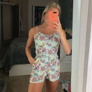 H&M baby blue floral romper with pockets.